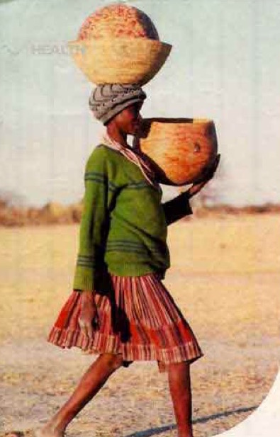 Girl Carrying Baskets